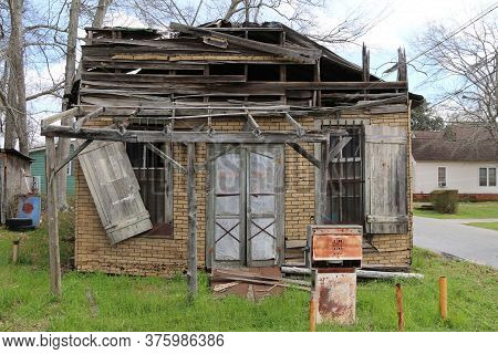 An Abandoned Boarded Old Country Gas Station Building