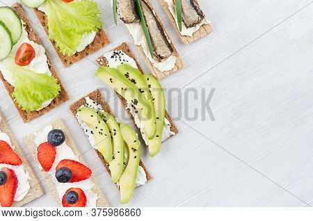 Assortment Of Fresh Summer Fruit Healthy Appetizers Of Crisps Breads With Fresh Vegetables, Ripe Fru
