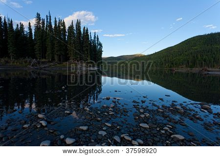 Taiga mirrored on Steward River near town of Mayo