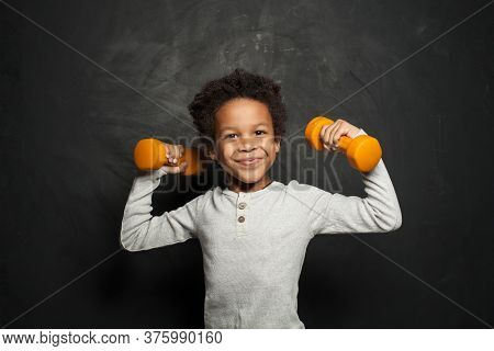 Happy Strong Black Child Boy With Dumbbells