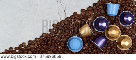 Caffeine, Hot Drinks And Objects Concept - Close Up Colorful Capsules Or Pods For Coffee Mashine Wit