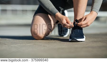 Morning Running. Young Man Tying Shoelaces On Sneakers, On Track, On Street, Panorama, Free Space, C
