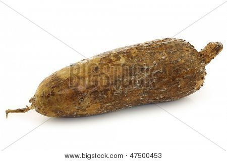 one whole cassava root on a white background poster