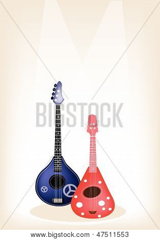 Two Beautiful Ukulele Guitar On Brown Stage Background