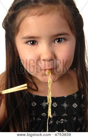 Young Girl Slurping Her Noodle Soup