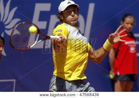 BARCELONA  - APRIL, 24: Argentinian tennis player Juan Monaco in action during a match of Barcelona tennis tournament Conde de Godo on April 24, 2013 in Barcelona