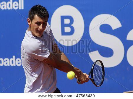 BARCELONA - APRIL, 23: Australian tennis player Bernard Tomic in action during his match against Kenny de Schepper of Barcelona tennis tournament Conde de Godo on April 23, 2013 in Barcelona