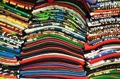 Stack of Colorful t-shirt for use as Background poster