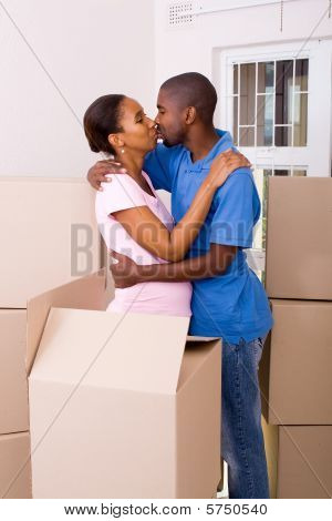 couple kissing in new home