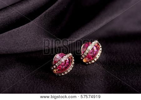 Beautiful jewelry jewelry on the background of silk