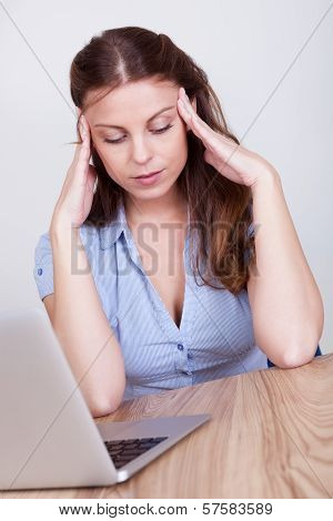 Woman Crumpling Paper In Frustration