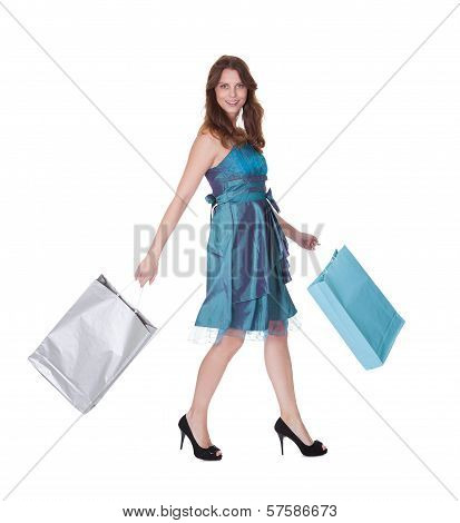 Beautiful Shopper With Hands Full Of Shopping Bags