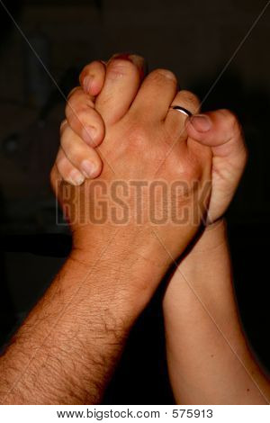 A pair of hands showing unity poster