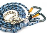 Isolated new climbing equipment - carabiners without scratches and blue rope poster