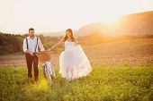 Beautiful bride and groom wedding portrait with white bike poster