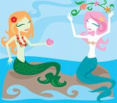 Two mermaids enjoying the ocean, sitting on rocks and playing with sea kelp poster