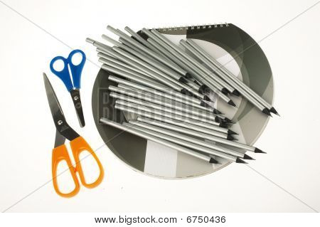 pencils scissors and notebook