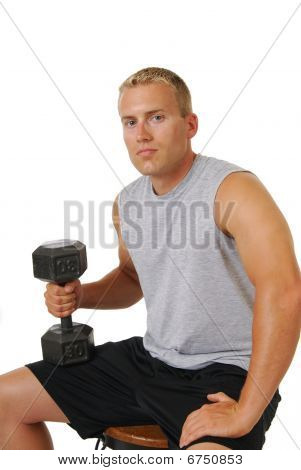 Muscular Man With Dumbells