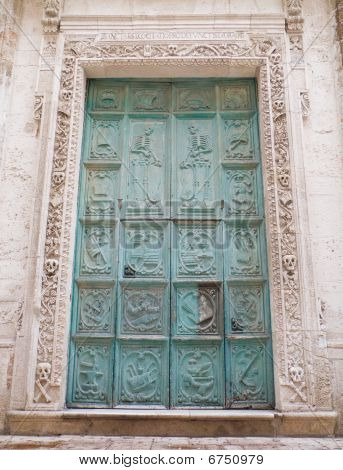 This is the ancient portal of the Purgatory church. Monopoli. Apulia. poster