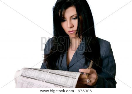 Business Woman Holding A Newspaper And Pen
