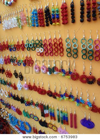 Display of handmade Mexican earing Jewelry at a market place in Manzanillo Mexico poster