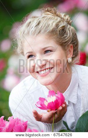 Beautiful Happy Woman In Flower Garden Smiling