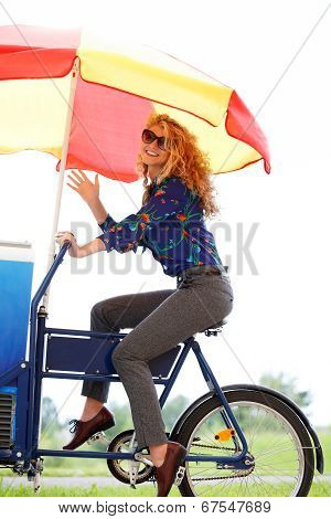 Positive Woman Selling Icecream On Special Bike