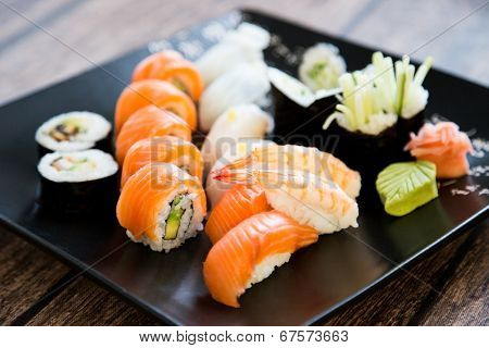 Japanese seafood sushi set on black background