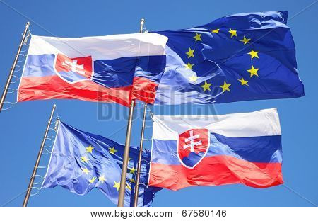 Flags of European Union and Slovakia in the wind