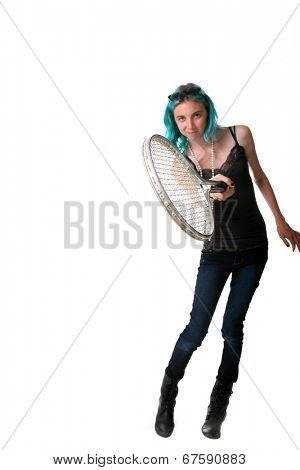A young woman with blue hair swing a tennis racket toward you the viewer, showing the proper posture to play tennis. Isolated on white with room for your text