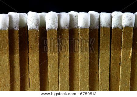 closeup of a row of paper white tipped matches