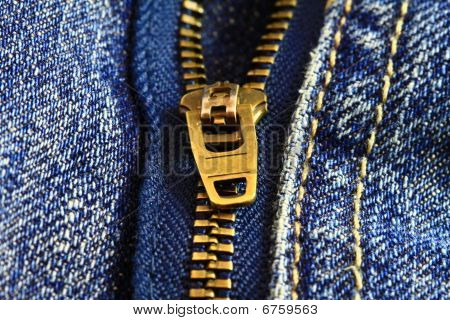 Closeup of a zipper on denim