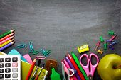School supplies on blackboard background ready for your design poster