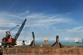 sand dredging crane and a scow poster