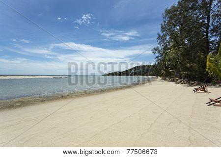 An empty beach in Thailand on a sunny day
