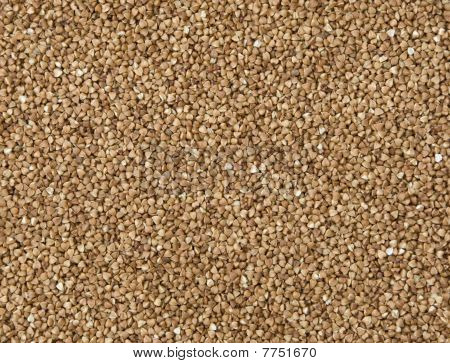 Brown buckwheat grains completely fill a background poster