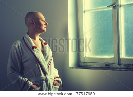 Bald Woman Suffering From Cancer Looking Throught The Hospital Window