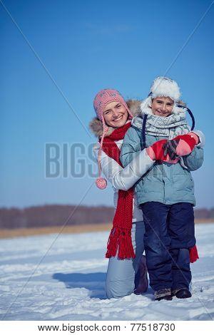 Happy woman and her little son in winterwear