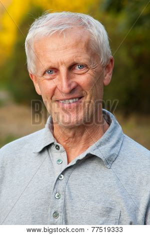 Closeup Portrait Of Happy Face Of Grey-haired Old Man. Outdoor