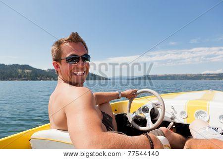 Smiling Man On Speedboat