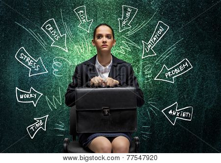 Upset businesswoman sitting on chair with suitcase in hands poster