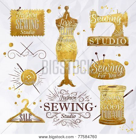 Sewing symbol in retro vintage in gold color lettering mannequin, coil, pins, hangers, buttons poster