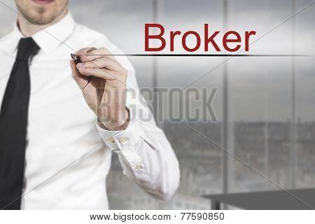 Businessman Writing Broker In The Air