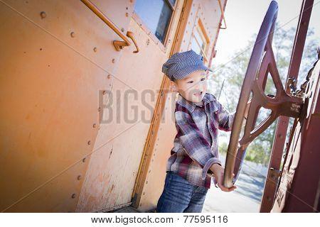 Cute Young Mixed Race Boy Having Fun Outside on Railroad Car.