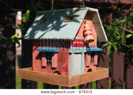 ornamental house feeder for the birds nuts poster