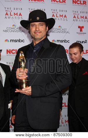 LOS ANGELES - SEP 27:  Robert Rodriguez at the 2013 ALMA Awards - Press Room at Pasadena Civic Auditorium on September 27, 2013 in Pasadena, CA