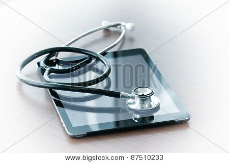 Studio Macro Of A Stethoscope And Digital Tablet With Shallow Dof Evenly Matched Abstract On Wood Ta