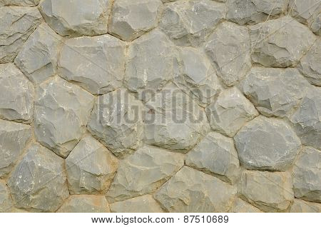 Part of a gray stone wall, for background or texture
