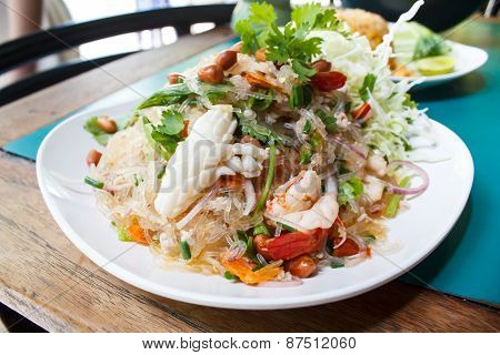 spicy noodle salad spicy vermicelli salad (yum woon sen) thai salad famous appetizer. poster