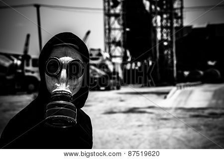 Monochromic portrait of man in respirator looking at the camera: environmental disaster concept poster